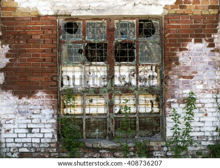 A large window in the abandoned old building - stock photo