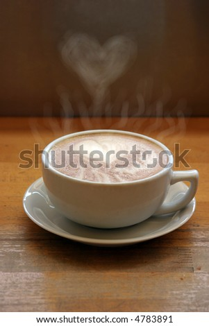 "a latte with ""latte art"" in foam as a heart of steam raises into the air in a ceramic cup in seattles world famous pike place market aka farmers market - stock photo"