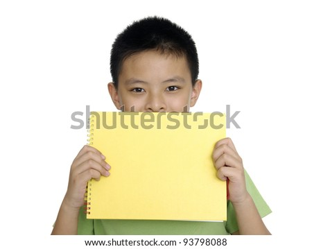 A laughing boy is holding a sheet of red paper - stock photo