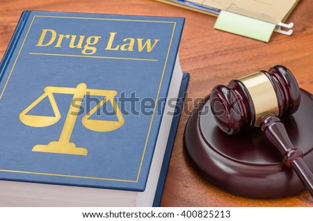 A law book with a gavel - Drug law - stock photo
