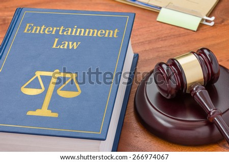 A law book with a gavel - Entertainment law - stock photo