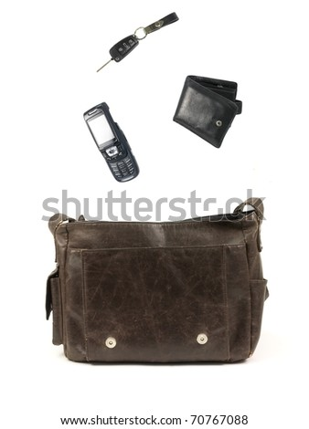 A leather bag and contents isolated against a white background - stock photo