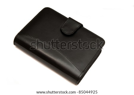 A leather bound dairy isolated on white background - stock photo