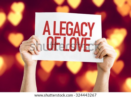 A Legacy of Love placard with heart bokeh background - stock photo