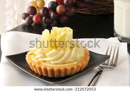 A lemon lime dessert tart on a white linen napkin - stock photo