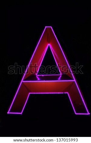 A letter decorated with electric lamps. - stock photo