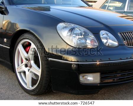 A Lexus luxury sedan headlight - stock photo