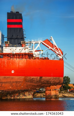 A lifeboat on the rear of a cargo ship. - stock photo