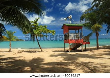 A lifeguard post stands in front of a calm turquoise bay at Seven Seas Beach near Fajardo, Puerto Rico - stock photo