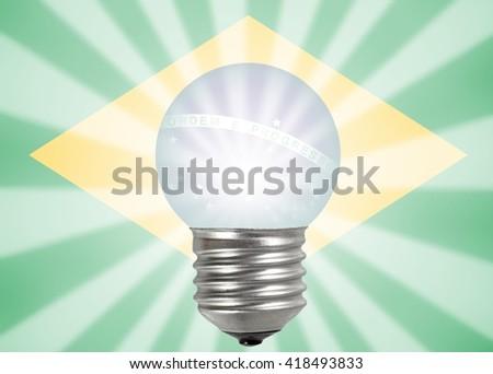 A light bulb illuminating the Brazil flag for the concept of Innovative Brazil.  - stock photo