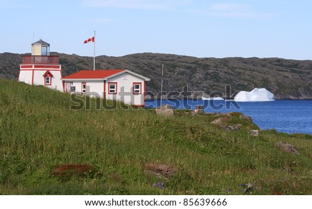 A lighthouse and keepers office at Fishing Point in St. Anthony, Newfoundland, Canada. - stock photo