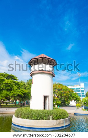 a lighthouse in the forest. - stock photo