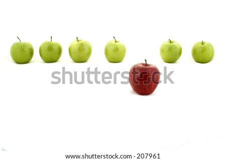 A line of green apples and one red apple - stock photo