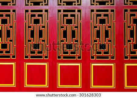 A line of red and gold Asian Themed Doors suitable for background with copyspace. - stock photo