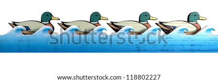 A literal depiction of carnival shooting alley wooden mallard ducks all in uniform rows behind a  blue wooden wave cutout on an isolated background - stock photo