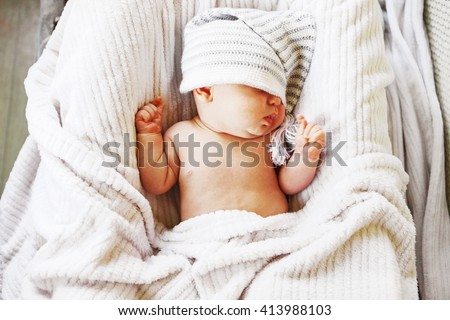 A little baby lies in the crib. - stock photo