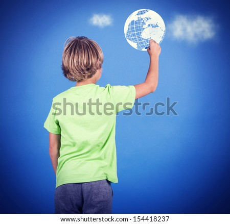 A little boy draws a map of the world in space. - stock photo