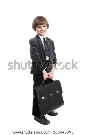 a little boy in a business suit with a leather briefcase - stock photo