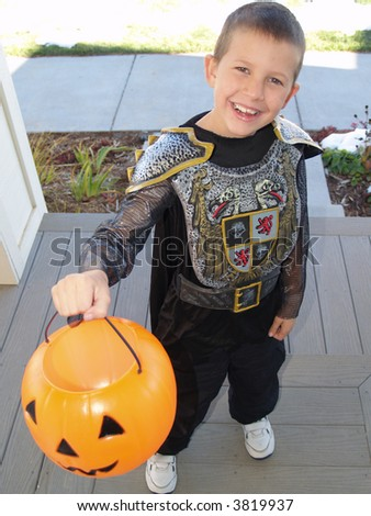 A little boy in a halloween costume trick or teats - stock photo