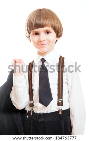 a little boy in a suit and tie - stock photo