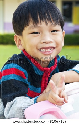 A little Boy in Car Toy pink color - stock photo