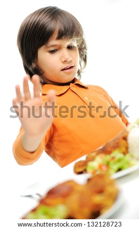 A little boy is heating a food, refusing food, kid does not want to eat - stock photo