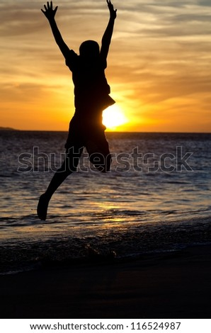 "A little boy jumping in the air at ""Big Beach on the Island of Maui in Hawaii. - stock photo"