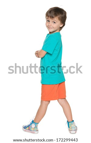 A little boy looks back on the white background - stock photo