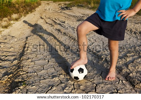 A little boy with football. Let's play! - stock photo