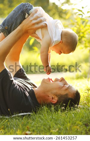 a little boy with his father on the nature - stock photo