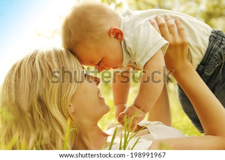 a little boy with his mother on nature - stock photo