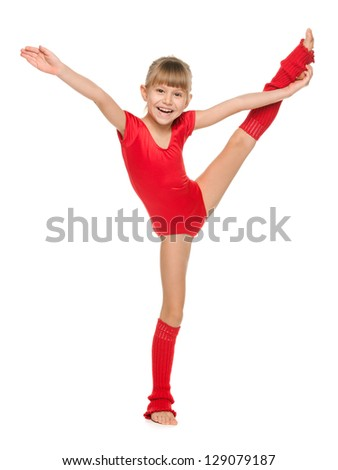 A little cheerful gymnast shows an exercise - stock photo