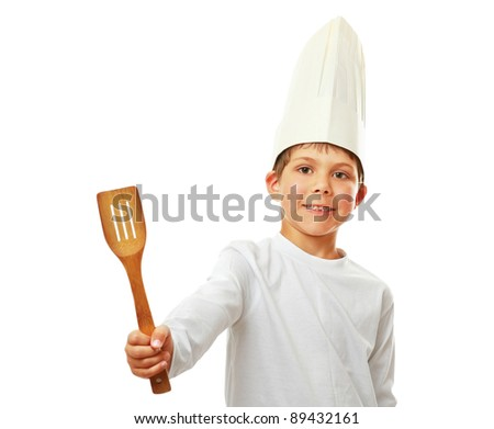 A little cook in uniform isolated on white background - stock photo