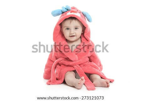 A little cute girl in a bathrobe isolated on a white background - stock photo
