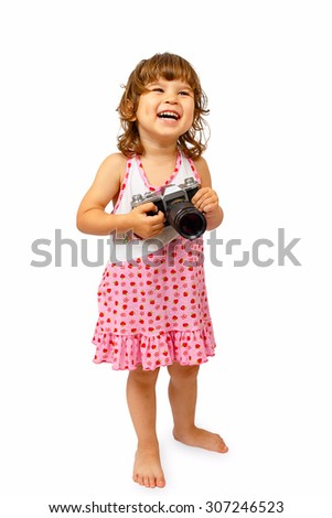 A little cute girl with camera isolated on white background - stock photo