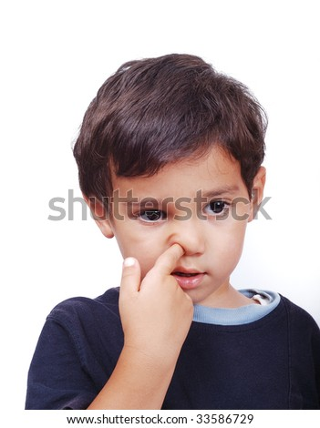 A little cute kid is playing with his nose - stock photo