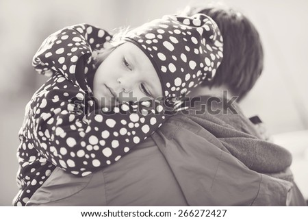a little daughter on the  father shoulder - stock photo