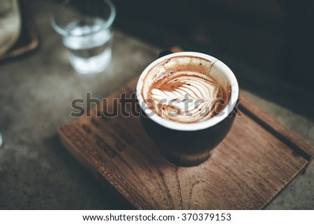 A little drink on beautiful latte art cappuccino - stock photo