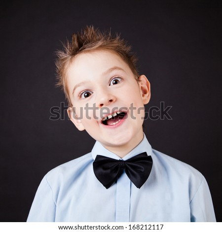 A little emotional  boy on the black background - stock photo
