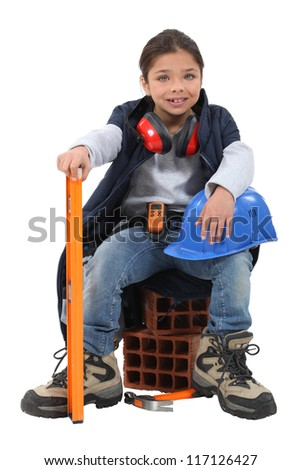 A little girl construction worker. - stock photo