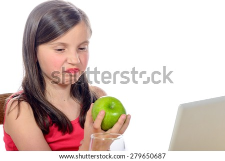 a little girl does not want apples on white background - stock photo