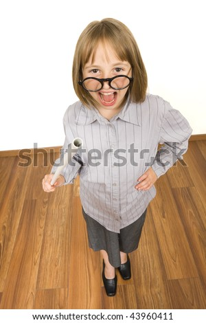 A little girl dressed up like a grownup teacher with a stick in her hand having cloths with big size - yelling loud. - stock photo