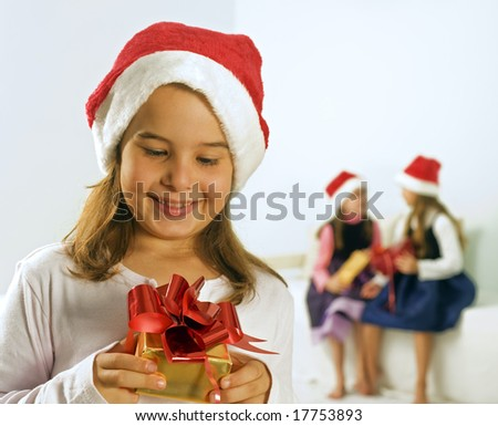 a little girl happy after receiving a present - stock photo