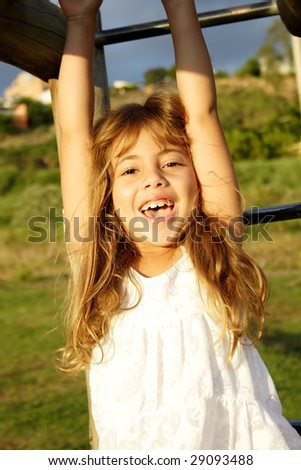 A little girl having a great time in an outdoor park. - stock photo