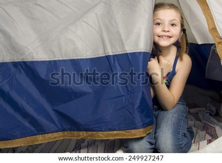 A Little girl having fun at home - stock photo