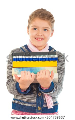 A little girl holding a big pile of books. Isolated on white background. - stock photo