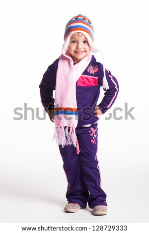 A little girl in winter clothing in the studio. - stock photo