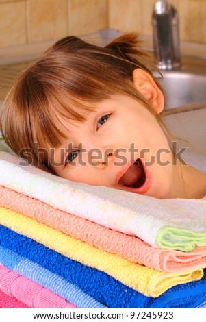 A little girl is happy with washing - stock photo