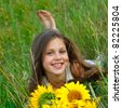 A little girl is in the field - stock photo