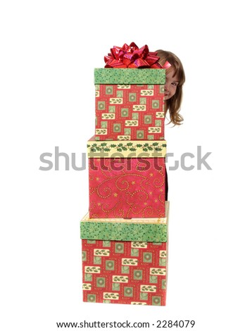 A Little Girl Peeking From Behind Christmas Gifts on a White Background - stock photo
